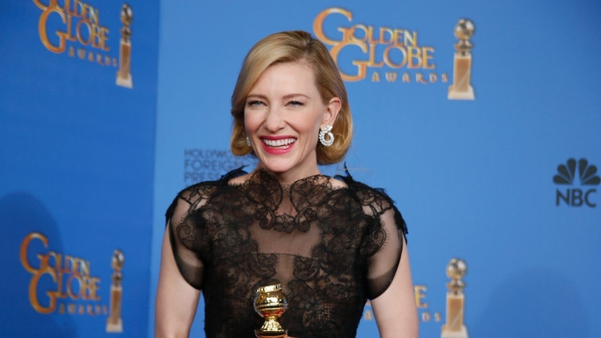 "January 12, 2014. Cate Blanchett poses backstage with her Best Performance by an Actress in a Motion Picture - Drama Award for ""Blue Jasmine"" at the 71st annual Golden Globe Awards in Beverly Hills, California."