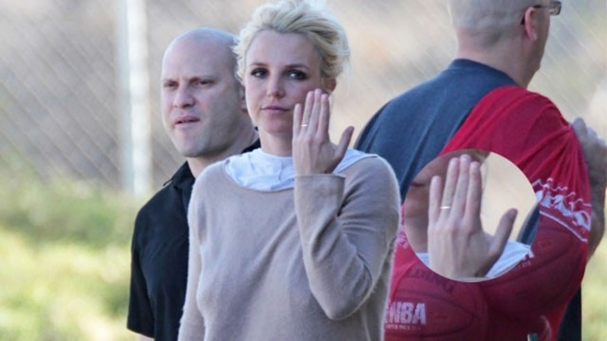 January 25, 2014. Britney Spears flashing a thin gold band on wedding ring finger at her son's soccer match.