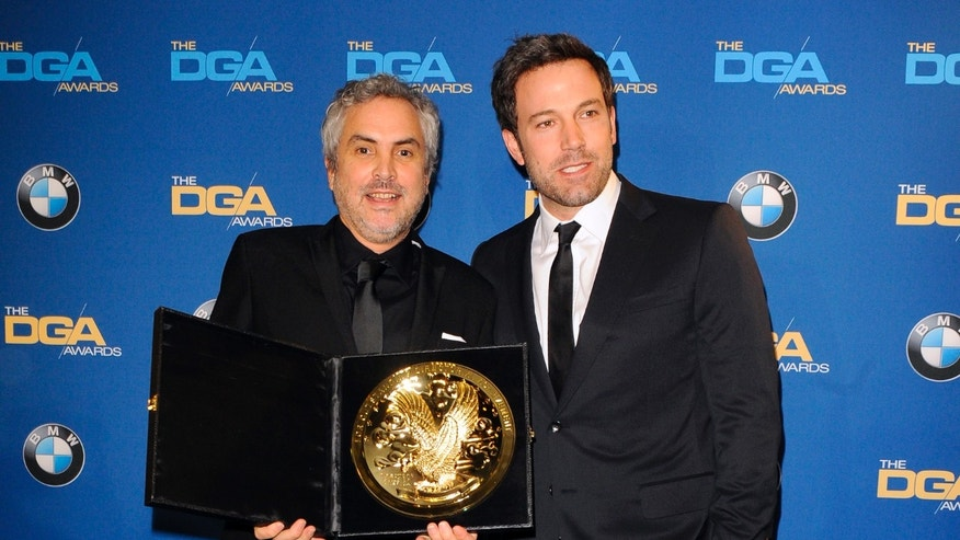 "January 25, 2014. Actor and director Ben Affleck (R) presents Mexican director Alfonso Cuaron with the Feature Film award for ""Gravity""during the 66th annual Directors Guild of America Awards in Beverly Hills, California."
