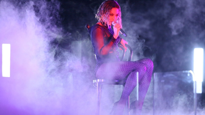"Beyonce performs ""Drunk in Love"" at the 56th annual Grammy Awards at Staples Center on Sunday, Jan. 26, 2014, in Los Angeles. (Photo by Matt Sayles/Invision/AP)"