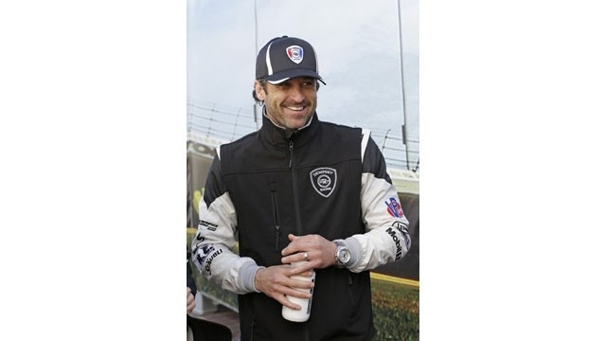 January 25, 2014: Driver Patrick Dempsey laughs with other drivers in the Fanzone area during an autograph session prior to the start of the IMSA Series Rolex 24 hour auto race at Daytona International Speedway in Daytona Beach, Fla. (AP Photo/John Raoux)