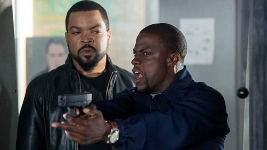 "This image released by Universal Pictures shows Ice Cube, left, and Kevin Hart in a scene from ""Ride Along."""