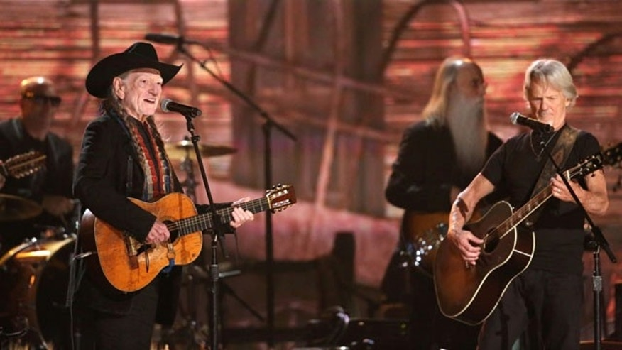 January 26, 2014: Willie Nelson, left, and Kris Kristofferson perform on stage at the 56th annual Grammy Awards at Staples Center in Los Angeles. (Photo by Matt Sayles/Invision/AP)