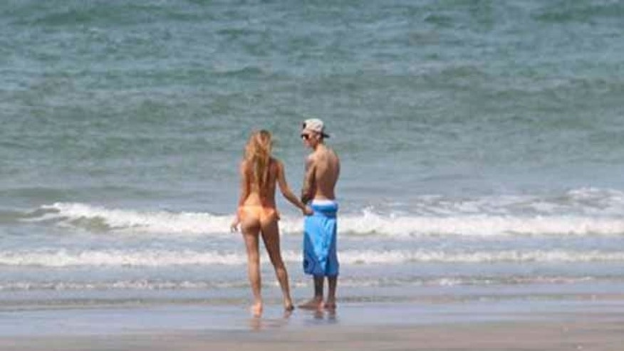 Justin Bieber stands with Chantel Jeffries on the shoreline at a beach in Punta Chame, Panama, Saturday, Jan. 25, 2014.
