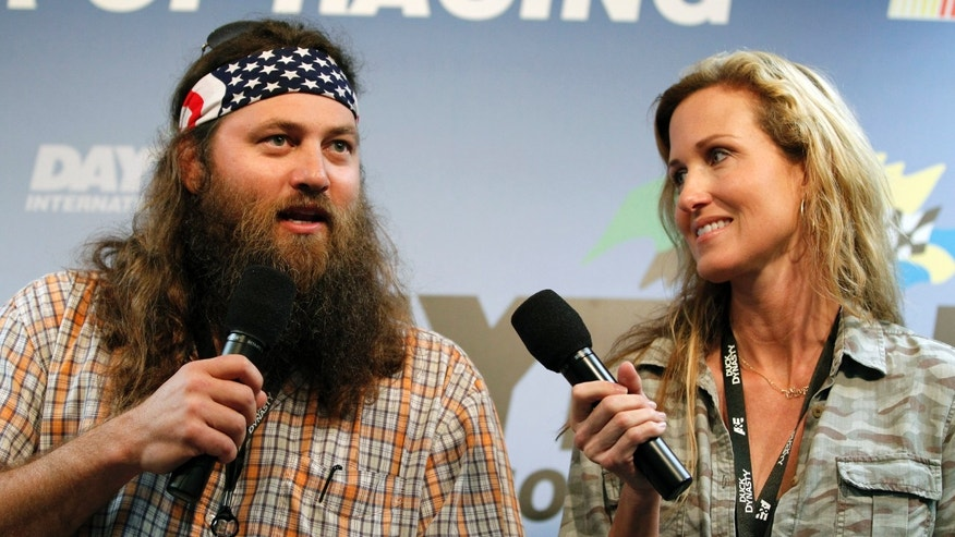 "Feb. 24, 2013. Willie Robertson, left, and Korie Robertson, of the reality TV show ""Duck Dynasty"", before the Daytona 500 NASCAR Sprint Cup Series auto race, at Daytona International Speedway in Daytona Beach, Fla."