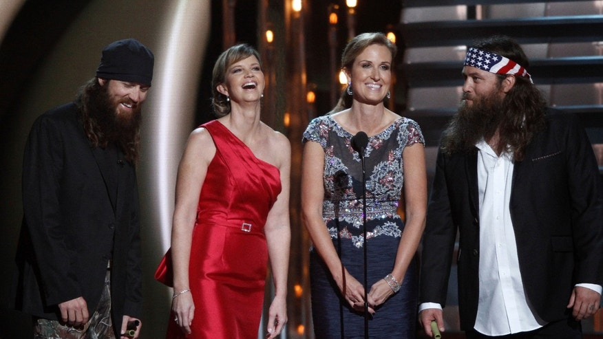 "Nov. 6, 2013: ""Duck Dynasty"" cast members, from left, Jase Robertson, Missy Robertson, Korie Robertson and Willie Robertson speak onstage at the 47th annual CMA Awards at Bridgestone Arena, in Nashville, Tenn. (AP)"