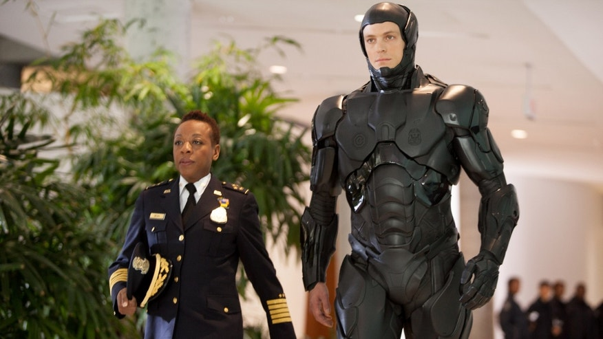 "Marianne Jean-Baptiste and Joel Kinnaman in Columbia Pictures' ""RoboCop."""