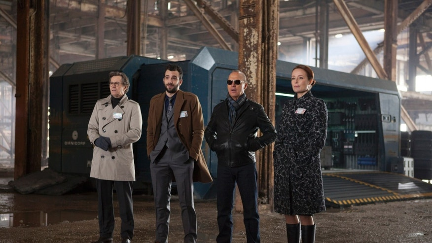 (L-r) Gary Oldman, Jay Baruchel, Michael Keaton and Jennifer Ehle in MGM/Columbia Pictures' ROBOCOP.