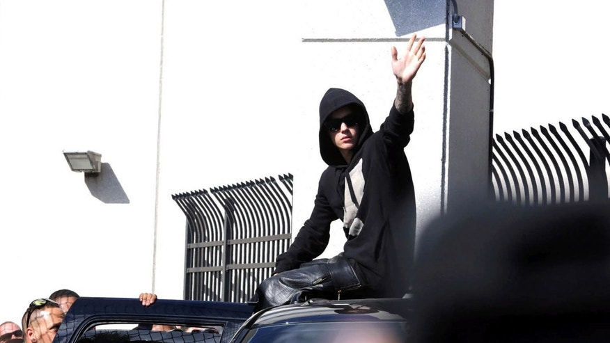 FILE - In this Jan. 23, 2014, file photo, singer Justin Bieber leaves the Turner Guilford Knight Correctional Center in Miami. Bieber's court cases on both sides of the U.S.-Canadian border might not just lead to more scrutiny by judges and prosecutors, but could also complicate the pop star's jet-setting ways. Legal experts say the decision by Toronto authorities to charge Bieber with assault makes the singer's legal situation more complicated and difficult to untangle.  (AP Photo/El Nuevo Herald, Hector Gabino, File)