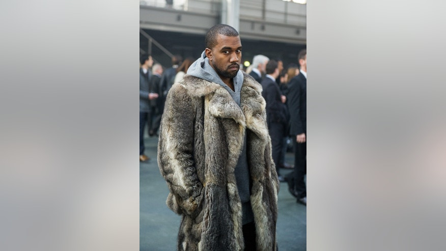 Jan. 17, 2014. Kanye West arriving at the Givenchy men's Fall-Winter 2014-2015 fashion collection in Paris.