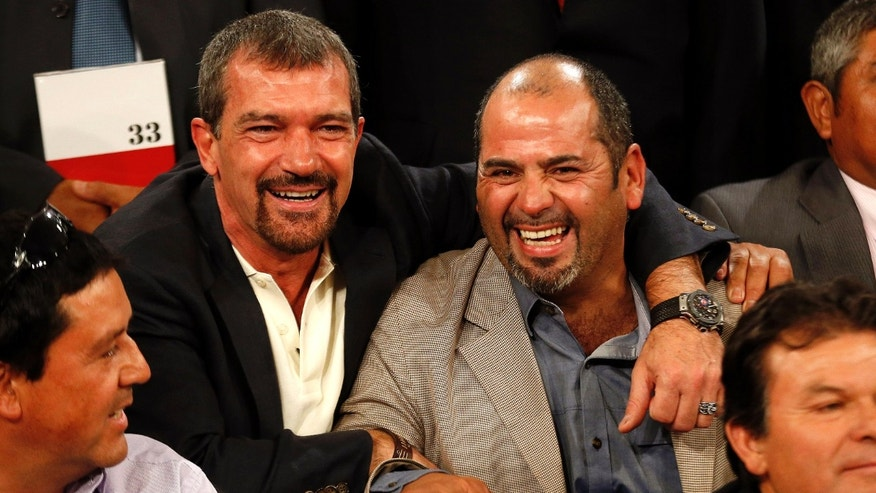 "January 31, 2014. Antonio Banderas (L) poses with former miner Mario Sepulveda during an official ceremony at the presidential palace in Santiago. Banderas is in Chile to begin filming of ""The 33,"" a film based on the true story of 33 miners who were trapped underground for some 69 days after a mining accident in 2010."