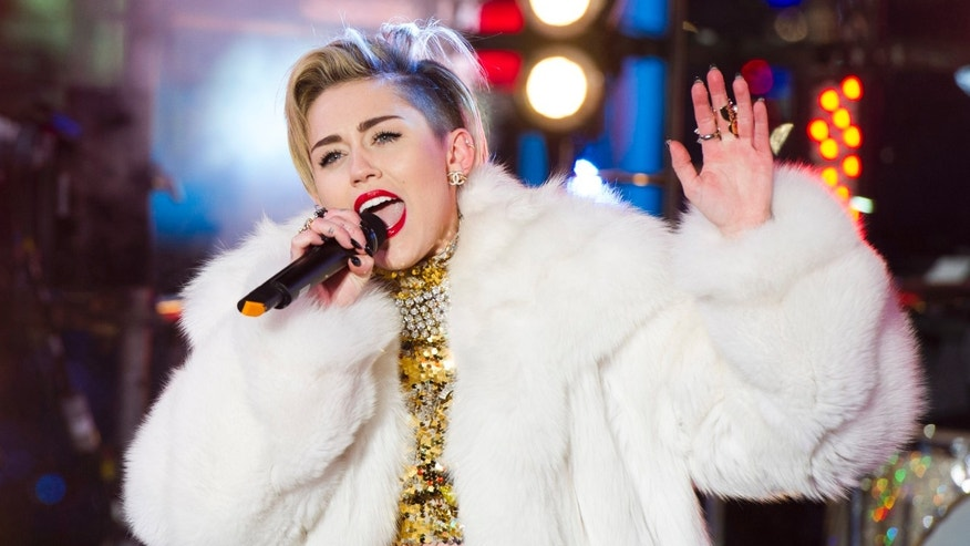 """Dec 13, 2013. Miley Cyrus performs in Times Square during New Year's Eve celebrations in New York. Cyrus is kicking off her North American """"Bangerz"""" tour Feb. 14, 2014, in Vancouver."""