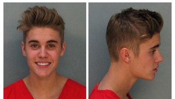 Canadian teen pop singer Justin Bieber is shown in this combo of booking photos provided by the Miami-Dade Corrections and Rehabilitation Department in Miami, Florida January 23, 2014. Bieber was arrested in south Florida early Thursday on a drunk driving charge after he was caught drag racing on a main thoroughfare in a rented yellow Lamborghini sports car, according to police.  REUTERS/Miami-Dade Corrections and Rehabilitation Department/Handout via Reuters   (UNITED STATES - Tags: ENTERTAINMENT CRIME LAW PROFILE TPX IMAGES OF THE DAY) ATTENTION EDITORS - THIS IMAGE WAS PROVIDED BY A THIRD PARTY. FOR EDITORIAL USE ONLY. NOT FOR SALE FOR MARKETING OR ADVERTISING CAMPAIGNS - RTX17RJL