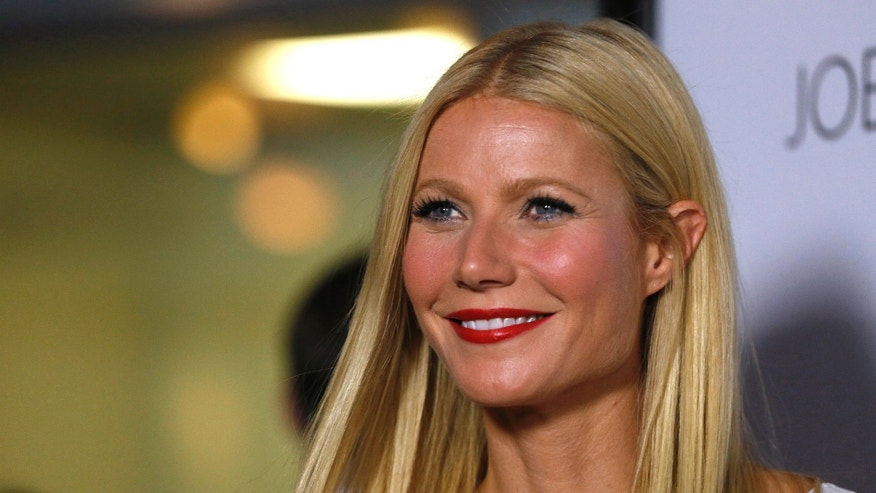 "Septmeber 16, 2013. Gwyneth Paltrow poses at the premiere of ""Thanks for Sharing"" in Los Angeles, California."