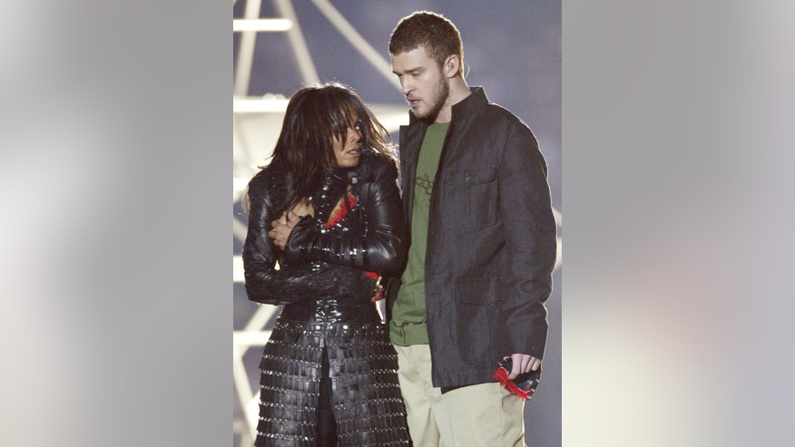 February 1, 2004. Janet Jackson (L) reacts after fellow singer Justin Timberlake ripped off one of her chest plates at the end of their half time performance at Super Bowl XXXVIII in Houston.