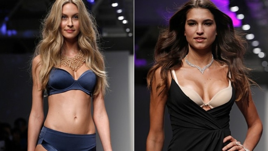 Models pause during the presentation of the GS Shop Lingerie show featuring Spanx, Wonderbra, Platex and Anna Sui during Fashion Week Tuesday, Feb. 4, 2014, in New York.