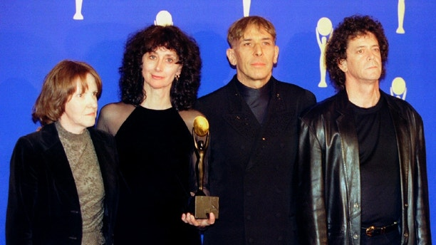 "The rock group ""The Velvet Underground"" (R-L) Lou Reed, John Cale, Martha Morrison (wife of Sterling Morrison) and Maureen Tucker, pose for photographers shortly after being inducted in the Rock & Roll Hall of Fame at the eleventh annual Rock & Roll Hale of Fame induction dinner at the Waldorf Astoria Hotel, in New York, January 17 - RTXGAJ2"