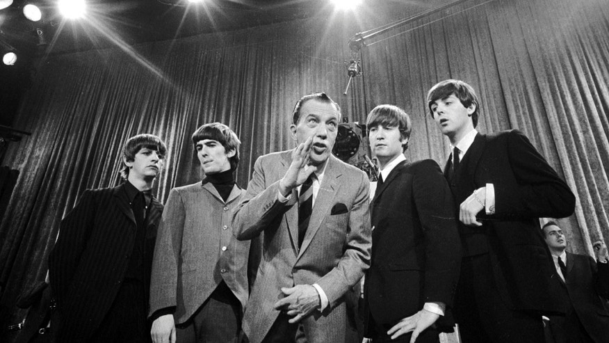 "Feb 9, 1964. Ed Sullivan, center, stands with The Beatles, from left, Ringo Starr, George Harrison, John Lennon, and Paul McCartney, during a rehearsal for the British group's first American appearance, on the ""Ed Sullivan Show,"" in New York. CBS is planning a two-hour special on Feb. 9, 2014, to mark the 50th anniversary of the Beatles' first appearance in America on ""The Ed Sullivan Show."""
