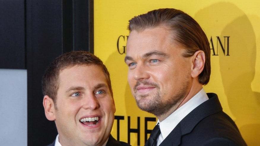"December 17, 2013. Leonardo DiCaprio (R) and Jonah Hill arrive for the premiere of the film ""The Wolf of Wall Street"" in New York."