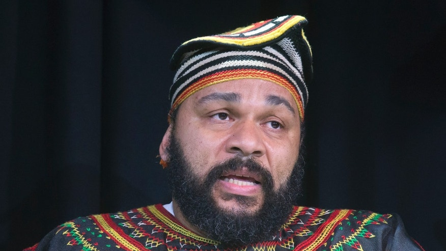 Jan. 11, 2014. French comic Dieudonne M'Bala M'Bala speaks to the media during a press conference in a theater in Paris. The French comic whose gesture touched off allegations of anti-Semitism and prompted a government ban on his shows is defiant, saying the quenelle has nothing to do with the Nazi salute.