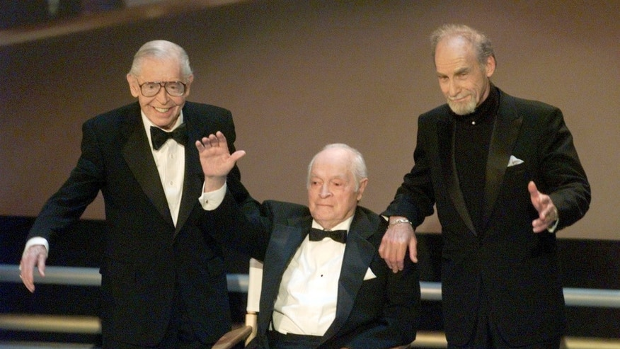 "Milton Berle (L), Bob Hope and Sid Caesar wave to the audience after being introduced on stage at the 50th Anniversay Emmy Awards in Los Angeles in this September 13 1998 file photo. Caesar, a pioneer of American television sketch comedy as the star and creative force of ""Your Show of Shows,"" during the 1950s, died on February 12, 2014 at age 91, according to his friend and former collaborator, Carl Reiner. REUTERS/Gary Hershorn/Files (UNITED STATES - Tags: ENTERTAINMENT OBITUARY PROFILE) - RTX18P4Z"