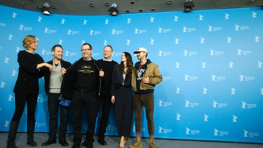 "February 9, 2014. Cast members Uma Thurman, Christian Slater, director Lars von Trier, Stellan Skarsgard, Stacy Martin and Shia LaBeouf (L-R) attend a photocall to promote the movie ""Nymphomaniac Volume I"" during the 64th Berlinale International Film Festival in Berlin."