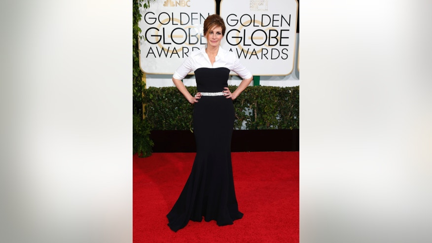 Actress Julia Roberts arrives at the 71st annual Golden Globe Awards in Beverly Hills, California January 12, 2014.  REUTERS/Danny Moloshok  (UNITED STATES - Tags: Entertainment)(GOLDENGLOBES-ARRIVALS) - RTX17BE6