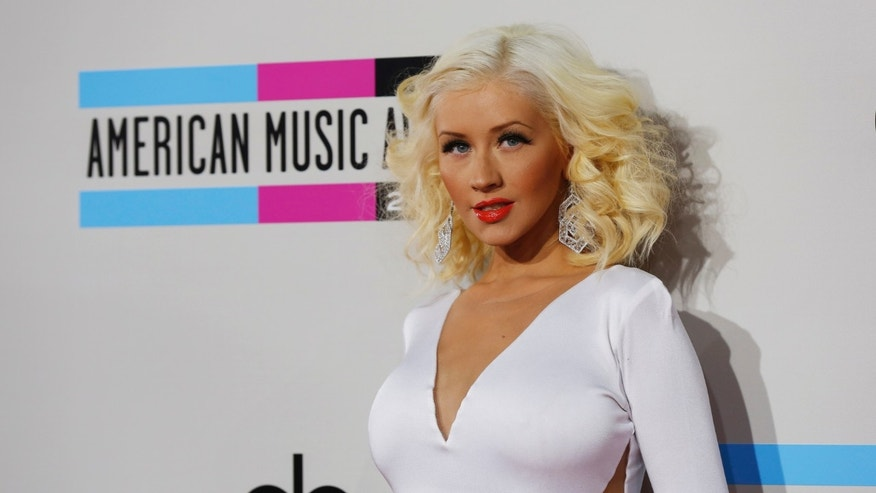 November 24, 2013. Christina Aguilera arrives at the 41st American Music Awards in Los Angeles, California November 24, 2013.