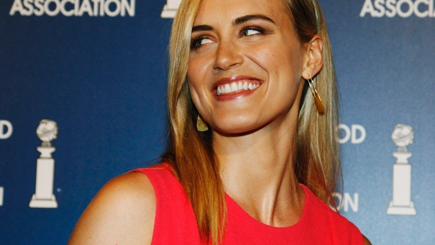 "Actress Taylor Schilling, star of the Netflix series ""Orange is the new Black,"" arrives at the Hollywood Foreign Press Association's annual luncheon in Beverly Hills, California August 13, 2013."