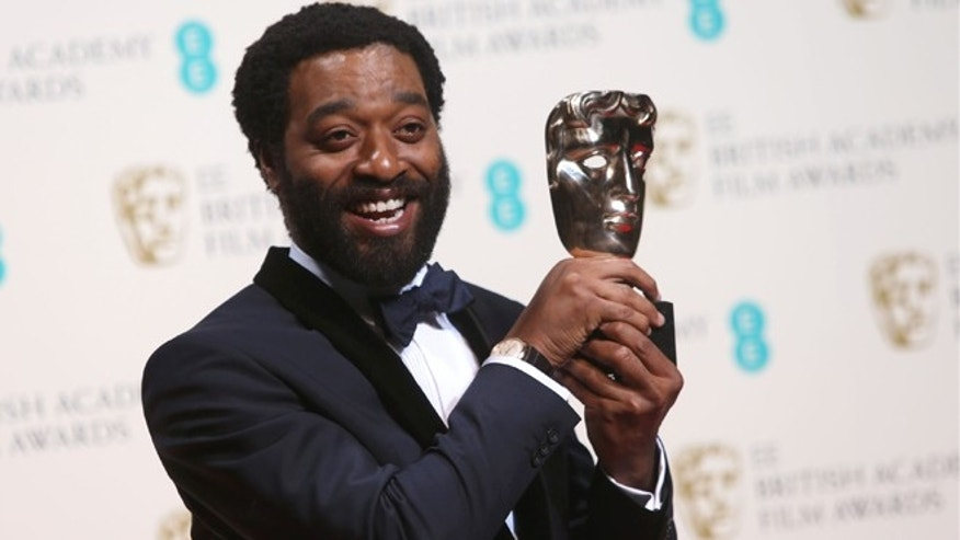 Feb. 16, 2014: Chiwetel Ejiofor, winner of the Best Actor BAFTA award for his role in '12 Years a Slave,' poses for photographers in the winners' room at the EE British Academy Film Awards held at the Royal Opera House.