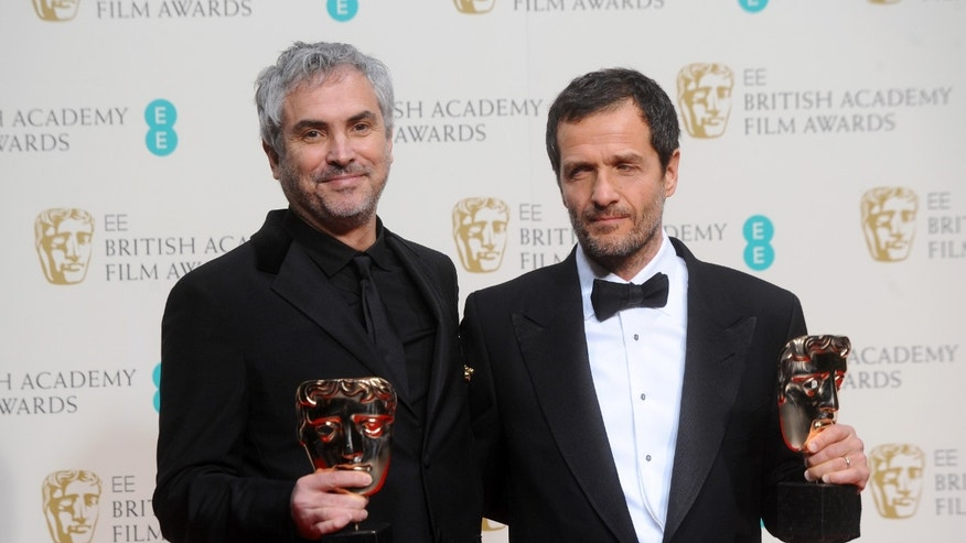 LONDON, ENGLAND - FEBRUARY 16:  Director Alfonso Cuaron and producer  David Heyman, winner of the Outstanding British Film award, pose in the winners room at the EE British Academy Film Awards 2014 at The Royal Opera House on February 16, 2014 in London, England.  (Photo by Anthony Harvey/Getty Images)