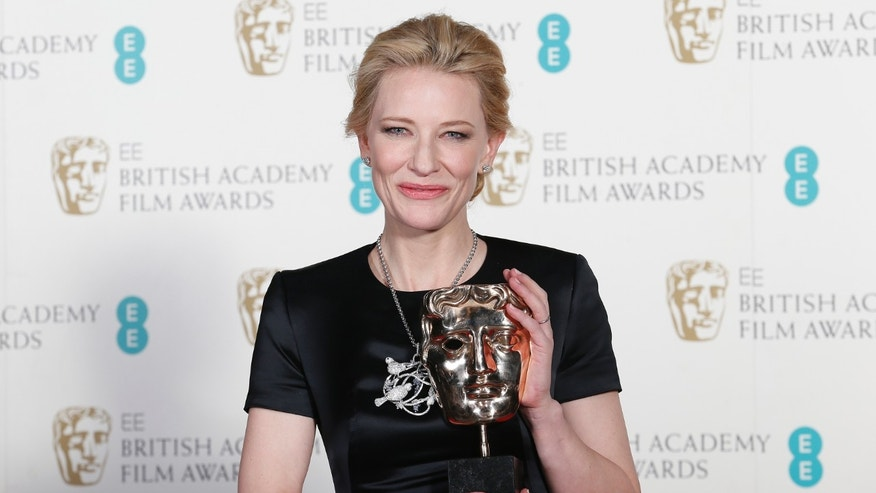 "Cate Blanchett celebrates winning Best Actress for ""Blue Jasmine"" at the British Academy of Film and Arts (BAFTA) awards ceremony at the Royal Opera House in London February 16, 2014. REUTERS/Suzanne Plunkett (BRITAIN - Tags: ENTERTAINMENT) - RTX18YKA"