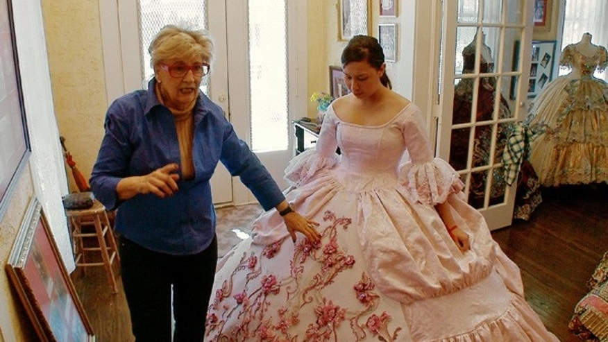 Dressmaker Linda Leyendecker Gutierrez works with Rosario on her gown