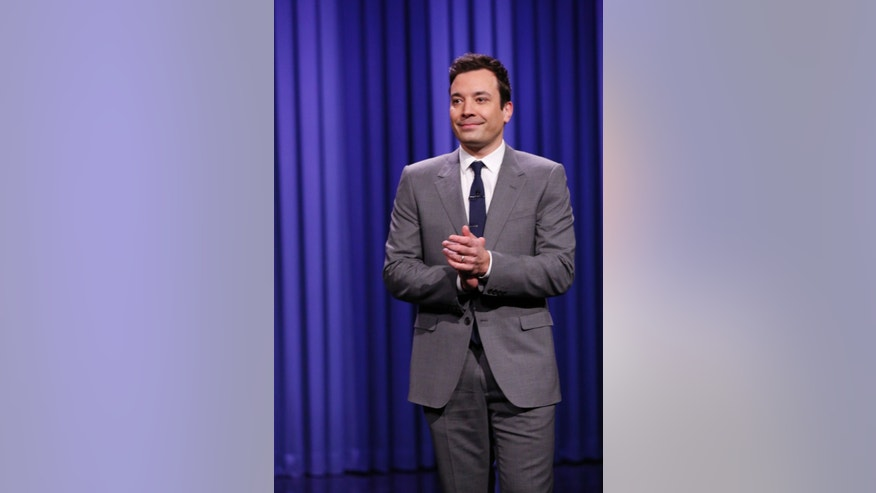 "In this photo provided by NBC, Jimmy Fallon appears during his ""The Tonight Show"" debut on Monday, Feb. 17, 2014, in New York. Fallon departed from the network's ""Late Night"" on Feb. 7, 2014, after five years as host, and is now the host of ""The Tonight Show,"" replacing Jay Leno after 22 years. (AP Photo/NBC, Lloyd Bishop)"