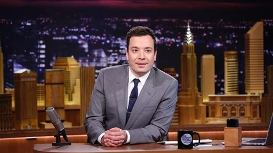 "In this photo provided by NBC, Jimmy Fallon appears during his ""The Tonight Show"" debut on Monday, Feb. 17, 2014, in New York. Fallon departed from the network's Late Night on Feb. 7, 2014, after five years as host, and is now the host of The Tonight Show, replacing Jay Leno after 22 years. (AP Photo/NBC, Lloyd Bishop)"
