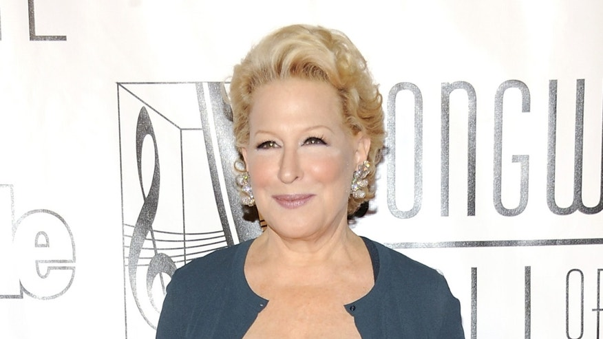 FILE - This June 14, 2012 file photo shows entertainer Bette Midler at the 2012 Songwriters Hall of Fame induction and awards gala in New York. Midler will perform at the Academy Awards, her first time at the Oscars. The Academy of Motion Picture Arts and Sciences announced Midler's booking Wednesday, Feb. 19, 2014. The show's producers declined to say what number Midler will perform. The Oscars will be hosted by Ellen DeGeneres. ABC will broadcast the show live March 2. (Photo by Evan Agostini/Invision/AP, file)
