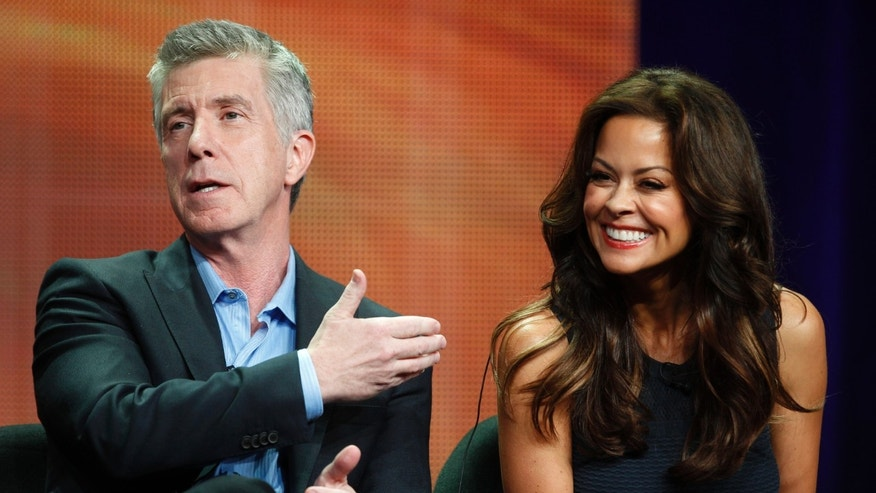 "July 27, 2012. Hosts Tom Bergeron and Brooke Burke-Charvet, of the upcoming reality series ""Dancing with the Stars: All Stars""; speak during a panel discussion at the Disney-ABC Television Group portion of the Television Critics Association Summer press tour in Beverly Hills, California."