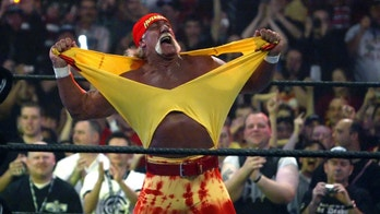FILE - in this April 3, 2005, file photo, Hulk Hogan fires up the crowd between matches during WrestleMania 21 in Los Angeles. Hogan, perhaps the biggest star in WWE's 50-year history, is set to bring the red-and-yellow back to the sports entertainment behemoth and will host the April 6, 2014, WrestleMania in New Orleans. (AP Photo/Chris Carlson, File)