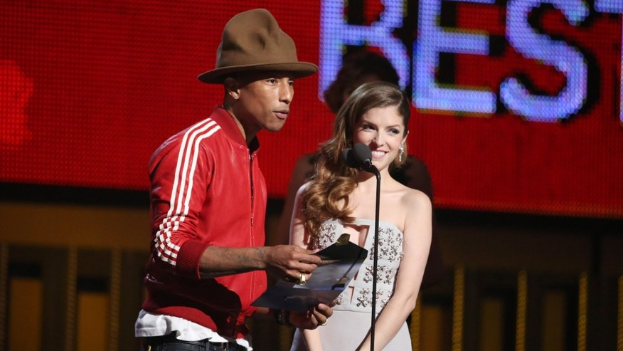 Jan. 26, 2014.  Pharrell Williams, left, and Anna Kendrick present the award for best new artist at the 56th annual Grammy Awards at Staples Center in Los Angeles.