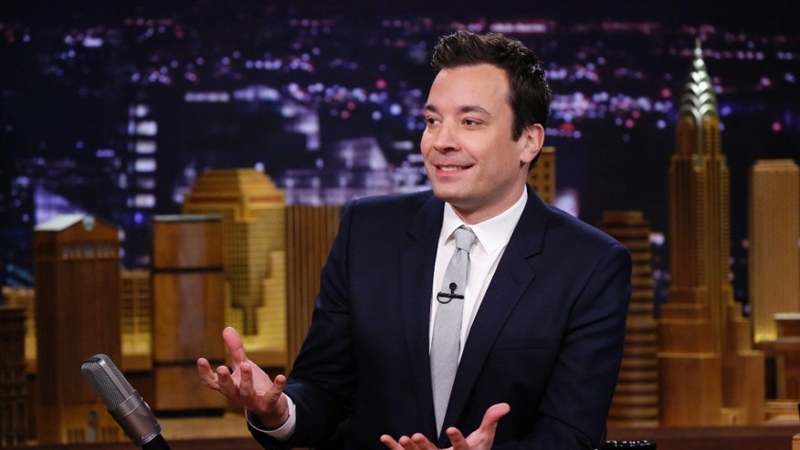 Feb. 18, 2014. Jimmy Fallon is seated at his desk during 'The Tonight Show Starring Jimmy Fallon,' in New York.