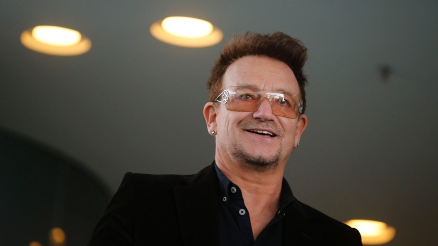 Bono, lead singer of the band U2 and ONE organisation co-founder arrives for a reception with German Chancellor Angela Merkel and with youth representatives of the organisation ONE against human poverty in Berlin April 8, 2013.