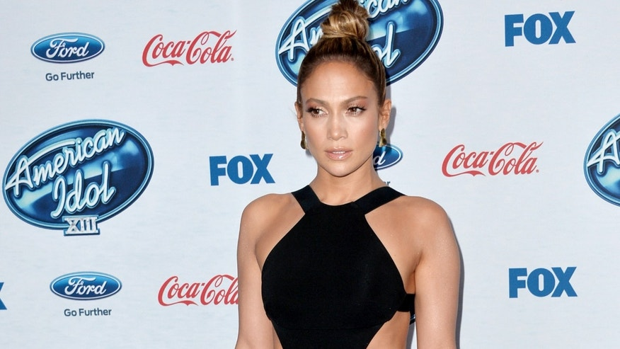 "WEST HOLLYWOOD, CA - FEBRUARY 20:  Actress/singer Jennifer Lopez arrives at Fox's ""American Idol Xlll"" Finalists Party at Fig and Olive on February 20, 2014 in West Hollywood, California.  (Photo by Kevin Winter/Getty Images)"