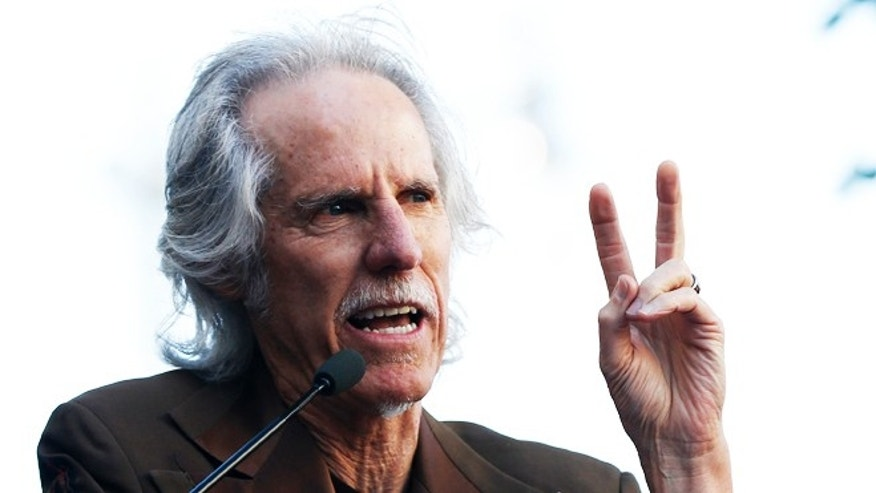 John Densmore, drummer of the The Doors, speaks at a ceremony for the unveiling of the star for rock band Jane's Addiction on the Walk of Fame in Hollywood, California October 30, 2013.   REUTERS/Mario Anzuoni  (UNITED STATES - Tags: ENTERTAINMENT) - RTX14UEJ