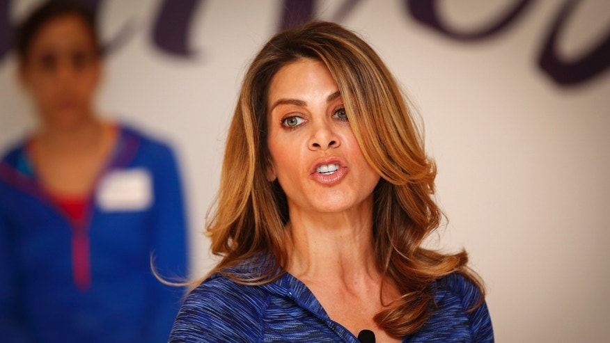 January 15, 2014. Fitness guru Jillian Michaels gives exercise instructions while promoting her new workout for the Curves franchise in New York.