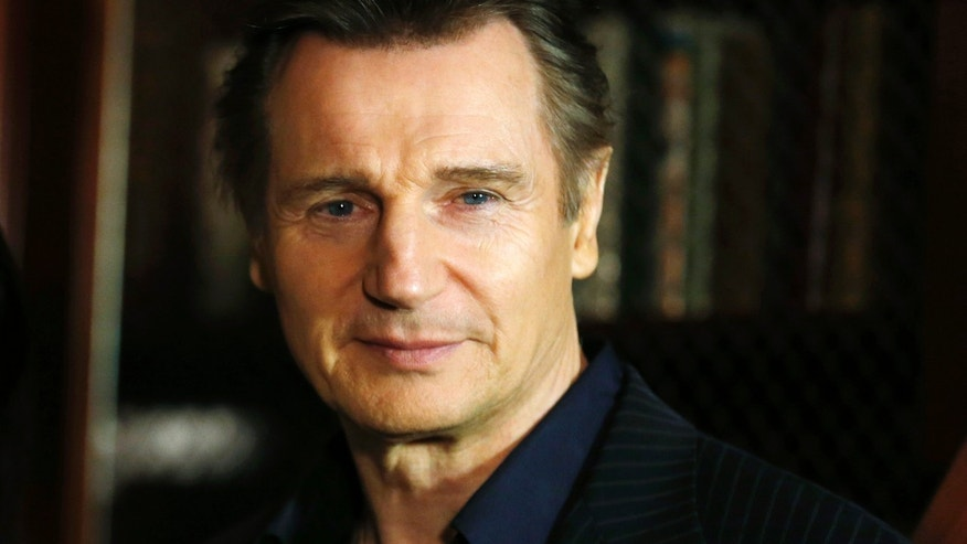 "January 30, 2014. Liam Neeson poses during a media event to promote the film ""Non-Stop"", in London."