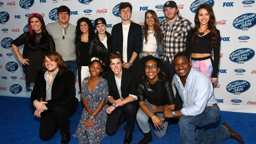 "Feb. 20, 2014: Finalists (from L-R standing) Jessica Meuse, Dexter Roberts, Jena Irene, MK Nobilette, Alex Preston, Emily Piriz, Ben Briley, Kristen O'Connor, (from L-R kneeling) Caleb Johnson, Majesty Rose, Sam Woolf, Malaya Watson and C.J. Harris pose at the party for the finalists of ""American Idol XIII"" in West Hollywood, California."