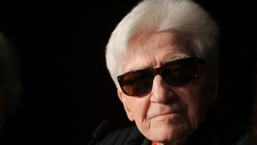 May 21, 2012: In this file photo, director Alain Resnais listens during a press conference for You Havent Seen Anything Yet at the 65th international film festival, in Cannes, southern France.
