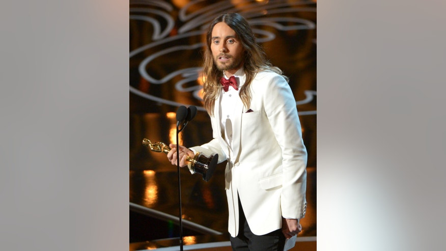 Jared Leto accepts the award for best actor in a supporting role for Dallas Buyers Club during the Oscars at the Dolby Theatre on Sunday, March 2, 2014, in Los Angeles.  (Photo by John Shearer/Invision/AP)
