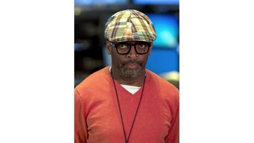 File-This July 31, 2013, file photo shows filmmaker Spike Lee being interviewed on the floor of the New York Stock Exchange. Lee has engaged in a brief and lively profanity-laced debate about gentrification of largely black New York City neighborhoods. (AP)