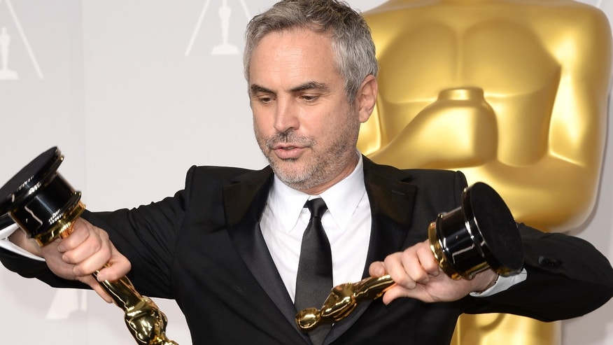 HOLLYWOOD, CA - MARCH 02:  Director Alfonso Cuarón, winner of Best Achievement in Directing poses in the press room during the Oscars at Loews Hollywood Hotel on March 2, 2014 in Hollywood, California.  (Photo by Jason Merritt/Getty Images)